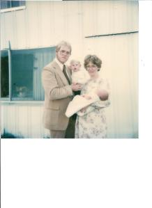 My dad, my brother (16 months old), my Mom & me at my blessing/christening.